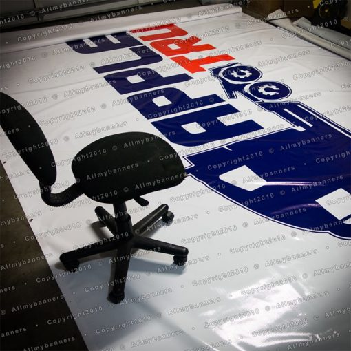 Big banner compared to a chair